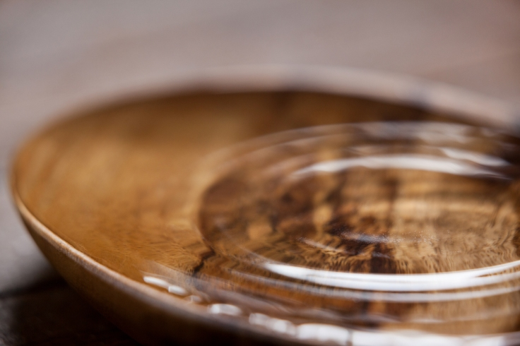 Water ripples in a wooden bowl